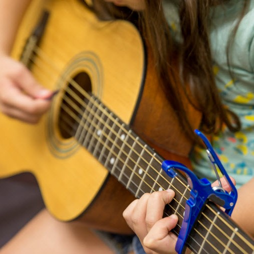 Child Practicing Guitar